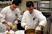 Flights' Chef Dean Wendell, right, prepares food for the evening, with help from one of his sous chefs.