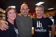 Scot Covington, center, poses for a photo with Ellen and Bruce McKim, owners of the wine store, Bottle Mixx.