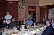 Scot Covington, at the head of the table, and his guests enjoy a family-style meal during a wine dinner at Maggiano's in Durham.