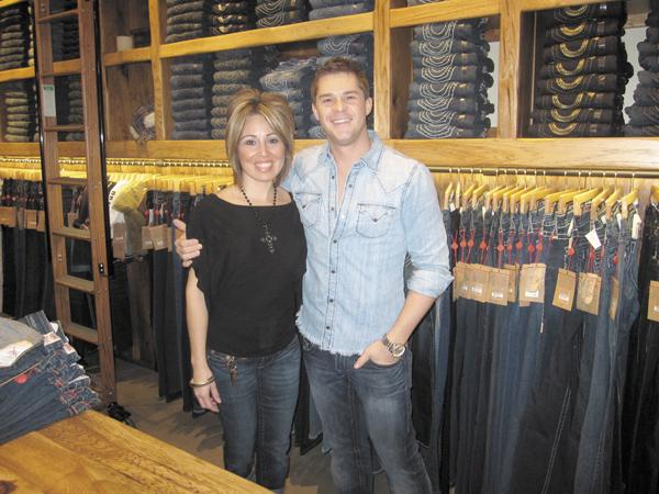 Pair show off True Religion wear at a True Religion store in Phoenix.