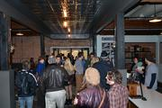 A crowd enjoys the grand opening event at Videri Chocolate Factory.