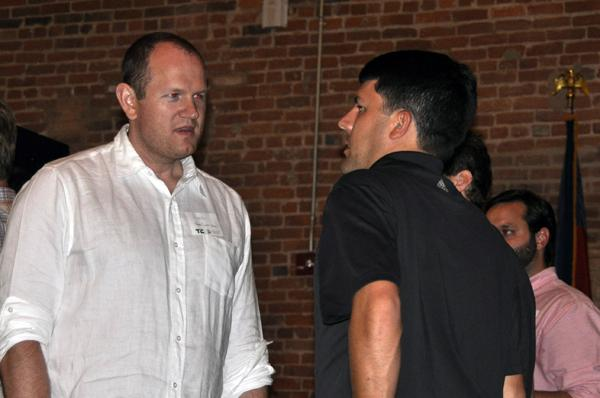 Founder of recently acquired iContact Aaron Houghton, left, discusses his new company, BoostSuite, at the TechCrunch event.