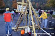 Organizers get the trebuchet ready for the pumpkins.