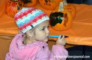 Even the little ones got involved in decorating those orange gourds.