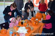 The kids at the Pumpkin Chunkin' had their own table to design their gourds.
