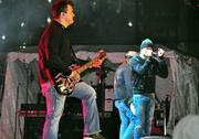 Chris Henderson, from left to right, Brad Arnold and Todd Harrell of 3 Doors Down perform at All-Star Wide Open.