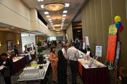 Exhibitors set up outside of the main dining area before the WIB event.