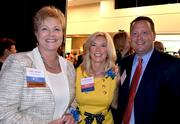 Cherry Bekaert's Sheila Ahler poses for a photo with 2012 award winner Carol Wagoner with Hill Chesson & Woody, center, and Todd Yates.
