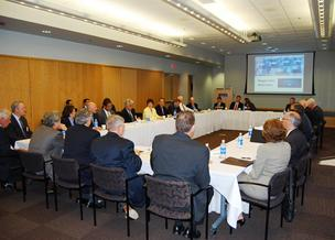 Members of the Jobs Council gather with representatives from the biotechnology industry at Biogen Idec.