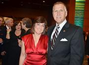 """Speaker of the House Thom Tillis and his wife, Susan, strike a pose.Tillis says that, since McCrory isn't above compromise, he expects more bipartisanship than in the previous administration.""""He's going to change the culture,"""" Tillis says of McCrory, calling Perdue and her team """"limited"""" in regards to compromise."""