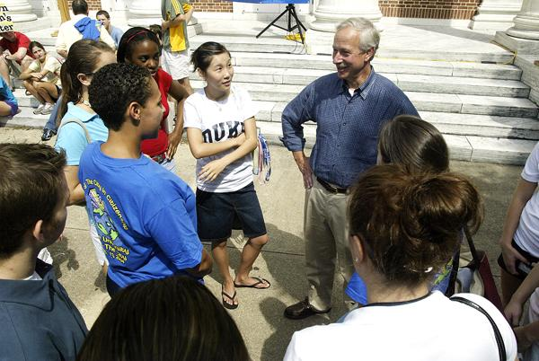 Duke University President Richard Brodhead chats with students on campus.