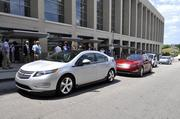 Two Chevrolet Volts outside the Raleigh Convention Center.