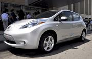 A silver Nissan LEAF sits outside of the Raleigh Convention Center.