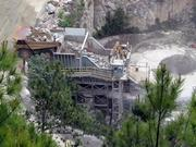 The quarry's extensive automation underscores its vastness. An employee there can go for a half hour before crossing paths with another of the 15 other people working the same shift. The five-inch pieces that exit the jaws of the main crusher near the quarry floor, shown here, tumble onto a zagging series of conveyor belts that carry them up to ground level.