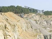 After going through a primary crusher, four-, five- and six-inch chunks of rock ascend a zagging series of conveyor belts, such as those in this photo, up to ground level. A pair of secondary crushers up top can reduce those pieces to sand. Each is essentially a metal cone that rolls and rotates within an outer cone, catching and crushing the rock. More often, they run on wider settings that result in gravel with widths of a quarter-inch to a couple of inches. A series of screens sorts the pieces onto various chutes.