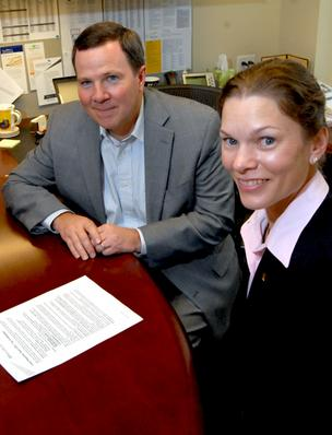 Michael Constantino, left, and Amy Baker of Ernst & Young's Raleigh office.