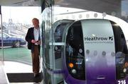 John Kane stands beside the first first ULTra System in operation, which is at London's Heathrow Airport.