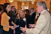 Gary Tomlinson, a volunteer with CZC-NC talks with Andrea Powell and Courtney Wilkinson.
