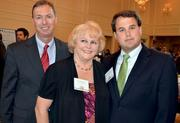 Employees with TrustAtlantic Bank pose for a photo. From left to right: John Anthony, Pat Thibault and Allen Suttle.