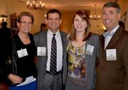 Candy Fuller, left, with the Mid-Atlantic Region of the Arthritis Foundation, poses with a trio of Kerr Health employees: Andy Maddigan, Rebecca Dotson and Joe Preston.