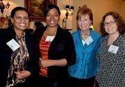 Richelle Mitchell (RHA Health Services), Rashelle Brooks (RHA Howell), Debbie Valentine (RHA Howell) and Tanya Jisa (Benevolence Farm) pose for a photo during the A Better World Awards luncheon.
