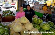 Watermelons and cantaloupes were just a few of the many items Heather Langdon and Leticia Ceres of Penny's Produce were selling at the farmers market.