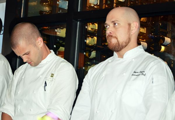 Chef John Childers of Herons, left, and Chef Ryan Payne of The  Weathervane await the announcement of the winner of the Fire in the Triangle cooking  competition.