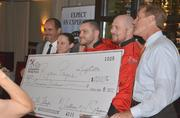 """Fire in the Triangle champion Chef Ryan Payne, second from  right, with his """"big check."""""""