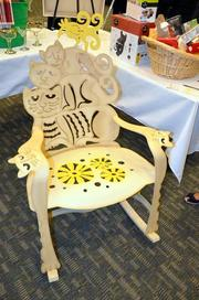 This cat chair, retailing for $900, was crafted by Don Drumm and went to the highest bidder.