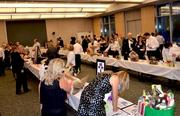 Once inside, people kept the bids flowing to win their favorite auction items.