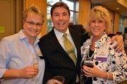 Safe Haven board of directors member Olga Wagner, left, along with volunteers Todd and Kim Reichert.