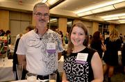 Volunteers Ray Dragon and Jennifer Connell enjoy the festivities at the 8th Annual Tuxedo Cat Ball.