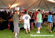 People trying to keep cool under the main tent at the Beer, Bourbon & BBQ Festival.
