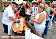 The line forms to take part in the live pig pickin' during day one of the festival.