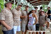 """A group of friends """"Armed & Hammered"""" enjoying the festivities at the festival."""