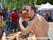 You ask a man to take a bite out of a pig's head because it would be a great photo … Ask and you shall receive.