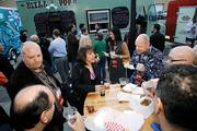 Employees at ChannelAdvisor, one of the 2012 Best Places to Work, enjoy food from a food truck.