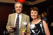 Debbie White, a finalist with CASA, and her husband Malcolm White, mingle at the reception at Fleming's.