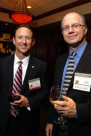 BofA's Keith Erazmus, left,  talks with finalist Arthur Bergens of Overture Networks Inc.