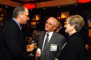 Finalists Arthur Bergens, left, and Andy Oakley chat with Andy's wife Peggy at the reception.