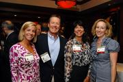 Winner Rudy Howard of SciQuest and his wife Nan, left, mingle with sponsor representatives Beth Monaghan and Laura Pettersen of the Monaghan Group.
