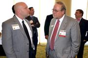 Harrington Bank's James Duncan, left, talks with Ray Clinebelle, who is with Cherry Bakaert & Holland LLP, a sponsor of the event.