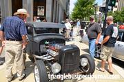 """This old """"moonshine"""" wagon had a lot of people stopping to take photos of its intricate details."""