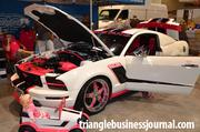 This definitely isn't Barbie's vehicle! A 2005 Ford Mustang V6 decked out in white and hot pink.