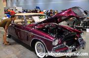 A man looks inside the confides of this 1958 Studebaker Golden Hawk hardtop.