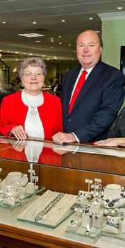 "Clyde Bailey, president of Bailey's Fine Jewelry, and his mother, ""Mama Ann,"" who started the business. ""I grew up in our family business being babysat in the store, behind the jewelry counter was my playpen.  My mother is now 87 years young and if we were to get into a conversation today she would remind of 3 things to operate our business. 1. ""You can't sell from an empty wagon,"" from her teaching me that I have always had all our Bailey's stores stocked with lots beautiful diamond jewelry and gifts. 2. My mother wore many hats, one being the bookkeeper, and my father was the watchmaker.  They worked side by side in our family business. As I was taking over the business in my 20s she reminded me 'Always pay all your bills first, and with what's leftover we eat.' 3. Lastly that comes to mind 'If you take good care of customers, they will take good care of you.'"""
