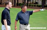 Heritage head golf professional David Sykes giving advice to TBJ's Cameron Snipes on Hole No. 18.