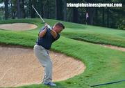 Heritage head pro David Sykes chips onto the green at No. 18.