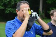 Duke's Ed Ibarguen scopes out distance to the hole through his range finder.