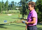 The Preserve's head golf pro Kathy Bounds readies to tee off at hole No. 8.